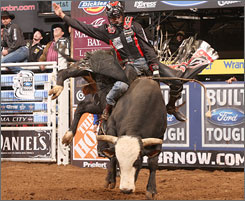 J.B. Mauney stays on Bones last winter. This weekend, the pair is entered in the Professional Bull Riders World Finals in Las Vegas.
