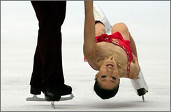 China's Shen Xue gets a close-up view of the ice as she performs with skating partner Zhao Hongbo.