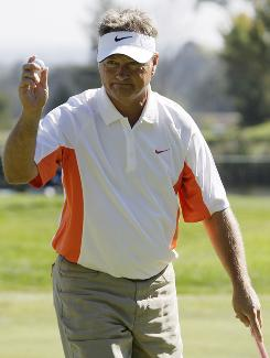 John Cook holds up his ball after making a birdie putt on the fourth green during the third round of the Charles Schwab Cup Championship golf event in Sonoma, Calif. Cook leads the tournament by six strokes after shooting five-under-par 67 to finish at total 19-under-par.