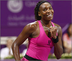 Venus Williams celebrates her three-set win over former No. 1 Jelena Jankovic in Qatar.
