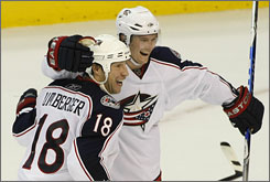 R.J. Umberger, celebrating with Blue Jackets teammate Anton Stralman, scored two goals, including the game-winning tally in overtime for Columbus.