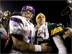 Brett Favre embraces his Packers replacement, Aaron Rodgers, after Minnesota defeated Green Bay 38-26.