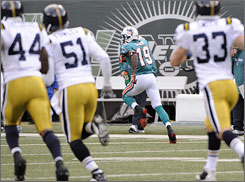 Ted Ginn races away from the Jets for one of his two TD returns on Sunday.