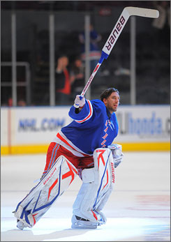 New York goalie Henrik Lundqvist salutes the crowd after his 1-0 win over the Boston Bruins on Sunday afternoon.