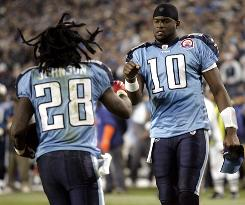 Tennessee Titans running back Chris Johnson (28) is congratulated by quarterback Vince Young (10).