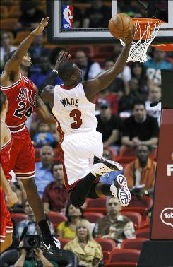 The Heat's Dwyane Wade, beating the Bulls' Tyrus Thomas to the basket, had 25 points Sunday and surpassed 10,000 for his career in Miami's victory.