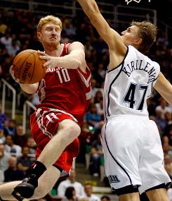 Houston Rockets forward Chase Budinger, left, puts up a shot against Utah Jazz forward Andrei Kirilenko with his eyes closed. The Rockets beat the Jazz 113-96 in Salt Lake City.