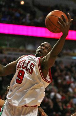 Luol Deng of the Chicago Bulls grabs one of his career-high 20 rebounds against the Milwaukee Bucks at the United Center on Tuesday in Chicago. Deng's play helped the Bulls win 83-81 in a nail-biter