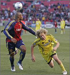 Real Salt Lake's Jamison Olave, left, fights for the ball with the Columbus Crew's Steven Lenhart on Saturday in the first leg of their playoff matchup.