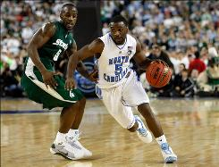 Ty Lawson of the North Carolina Tar Heels drives on Travis Walton of the Michigan State Spartans in the second half during the 2009 National Championship game in Detroit. The 2009 NCAA Tournament was carried by CBS, but ESPN has expressed interest, should the NCAA opt out of its TV deal.