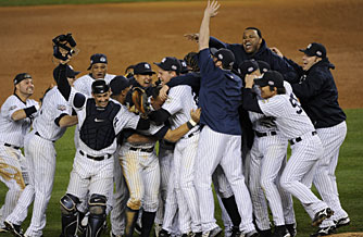 The Yankees, including Series MVP Hideki Matsui, second from right, celebrate their title. Matsui had a homer and six RBI in the Game 6 win.