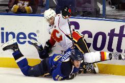 Calgary Flames' forward Jerome Iginla (12) collides with St. Louis Blues' Brad Winchester (15) during their game in St. Louis. The Flames won their second OT game in two nights thanks to a go-ahead goal by defenseman Dion Phaneuf.