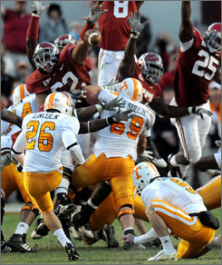 Alabama's Terrence Cody (62) blocks a potential game-winning field goal by Tennessee kicker Daniel Lincoln.