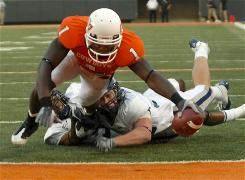 Oklahoma State wide receiver Dez Bryant stretches for the goal line while being tackled by Rice players Sept. 19. The NCAA effectively sacked Bryant's college football career when it denied his appeal seeking reinstatement Thursday.