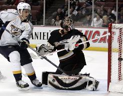 Anaheim Ducks goalie Jonas Hiller stops the shot from Nashville Predators center Marcel Goc, left, in Anaheim, Calif. Hiller had 40 saves as the Ducks blanked the Predators 4-0.