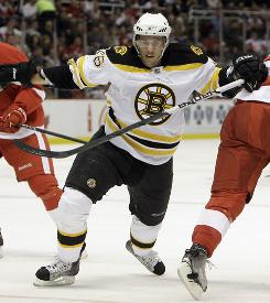 Boston Bruins center David Krejci, of the Czech Republic, splits Detroit Red Wing defenders Pavel Datsyuk and Niklas Kronwall in Detroit on Nov. 3. Krejci was diagnosed with swine flu and will be out for about 3-5 days.