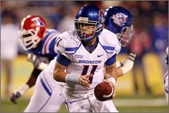 Boise State quarterback Kellen Moore threw for 354 yards and three touchdowns as the fifth-ranked Broncos stayed unbeaten.