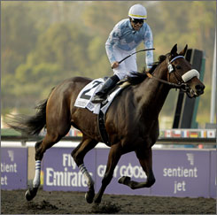 Jockey Garrett Gomez, riding Life is Sweet, reacts after winning the Breeders' Cup Ladies' Classic. Gomez rallied the filly from last to first during the stretch run.