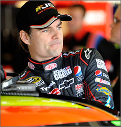 Jeff Gordon climbs into his No. 24 car before practice sessions at Texas Motor Speedway.
