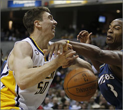 Indiana Pacers forward Tyler Hansbrough, left, defended by Washington Wizards forward Caron Butler, scored 13 points in 14 minutes in his NBA debut.