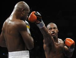 Chad Dawson, right, trades punches with Glen Johnson during their Saturday fight.