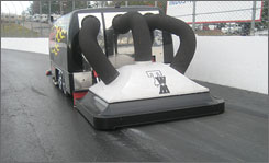 Rob Brush's invention takes the moisture out of the asphalt during a trial run this season at New Hampshire Motor Speedway.
