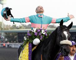 Jockey Mike Smith celebrates aboard Zenyatta after winning the Breeders' Cup Classic.