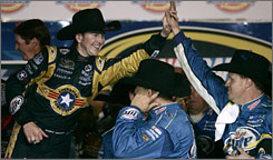 Kurt Busch dons a cowboy hat in victory lane as he slaps high-fives with his crew at Texas Motor Speedway.