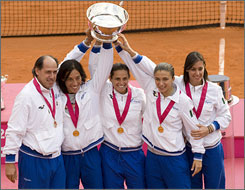 The Italian Fed Cup squad celebrates its victory over the United States Sunday in Italy.