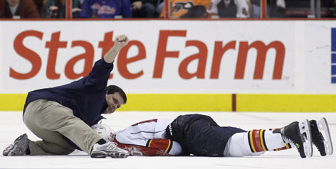 Florida's David Booth suffered a concussion on a legal check by Philadelphia's Mike Richards last month. The legal blindside check will be a topic at the general managers meetings in Toronto.