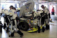 Jimmie Johnson's crew scrambles to get the No. 48 back together after his third-lap crash at Texas on Sunday.