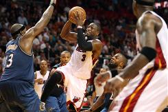 The Heat's Dwyane Wade has the ball blocked by the Washington Wizards' Brendan Haywood during the fourth quarter of Miami's 90-76 victory. The Wizards could not control Wade or the Heat for long, however, as he scored 41 points.