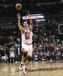 Bulls center Brad Miller launches a shot at the end of a game against the Denver Nuggets Tuesday in Chicago. After a lengthy review, the officials ruled time had expired, a call which the NBA deemed correct Wednesday.