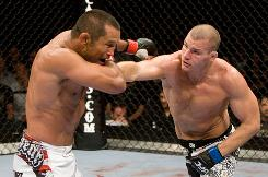 Michael Bisping, right, fights Dan Henderson at UFC 100 in July in Las Vegas before Henderson knocked him out.