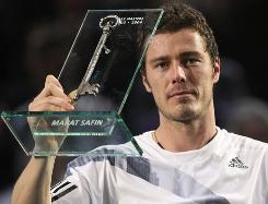 Marat Safin of Russia holds the key of the Bercy stadium, a farewell trophy to mark the end of his career, after his second-round loss to Juan Martin del Potro on Wednesday at BNP Masters indoor tennis tournament in Paris. The 29-year-old Safin, a two-time Grand Slam title winner, is retiring from tennis.