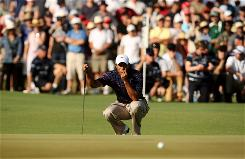Tiger Woods putts on the 14th hole during the first round of the Australian Masters at Kingston Heath Golf Club Thursday in Melbourne, Australia. He finished the round with a 6-under 66.
