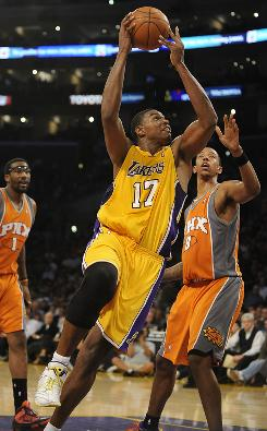 Center Andrew Bynum, driving past the Suns' Channing Frye, had 26 points and 15 rebounds and three blocks Thursday in the Lakers' victory.
