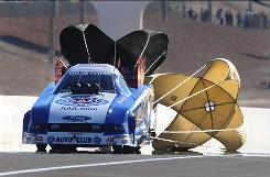 NHRA Funny Car driver Robert Hight, shown during second-round eliminations at the Las Vegas Nationals on Nov. 1, leads Ashley Force Hood by 105 points heading into the season's final race.