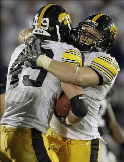 "Pat Angerer, right, with teammate A.J. Edds, says the Iowa defense has ""got to keep doing what we're doing."""