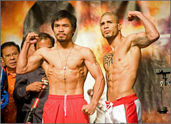 Miguel Cotto, right, weighed in at a contract-limit 145 pounds while Manny Pacquiao weighed in at 144 pounds for Saturday's WBO welterweight title fight.
