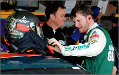 Dale Earnhardt Jr., with crew chief Lance McGrew in the background, gets ready to buckle in for practice runs at Phoenix.