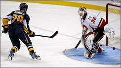 The Sabres' Jason Pominville watches the puck get past Flames goalie Miikka Kiprusoff to lift Buffalo over Calgary.