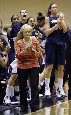 Virginia coach Debbie Ryan, watching her No. 18 Cavaliers take on UMBC, is in her 33rd year coaching the Cavaliers.