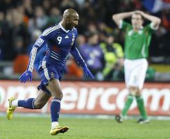 France's Nicolas Anelka reacts after scoring a goal against Ireland.