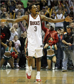 Brandon Jennings celebrates after scoring a career-high 55 points and rallying the Bucks to a 129-125 win over the Warriors.