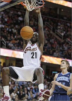 The Cavaliers' J.J. Hickson, dunking the ball in front of the Utah Jazz's Andrei Kirilenko, scored a career-high 20 points in Cleveland's 107-103 win.