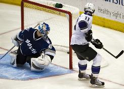 Tampa Bay Lightning goalie Antero Niittymaki looks over his shoulder as Los Angeles Kings center Anze Kopitar scores the game-winning goal during a shootout in their game in Tampa. The Kings won 2-1.