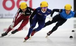 South Korean speed skater Lee Jung-Su, center, crosses the finish line ahead of Apolo Anton Ohno, right, and Canada's Charles Hamelin to win in the men's 1,500-meter finals Saturday in Marquette, Mich.
