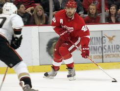 Detroit Red Wings' Henrik Zetterberg looks for a teammate through the Anaheim Ducks' defense during the first period of their game in Detroit. Zetterburg recorded a hat trick and two assists in the Red Wings' 7-4 victory.