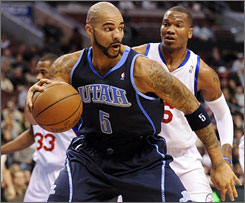 Utah's Carlos Boozer is averaging 17.6 points and 10.7 rebounds per game so far this season.
